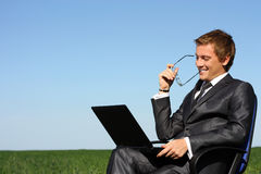 Businessman with a laptop. Happy, successful Royalty Free Stock Image