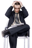 Businessman with laptop, holding head in hands. Over white background Royalty Free Stock Photography