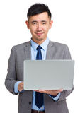 Businessman with laptop Stock Photography