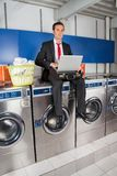 Businessman With Laptop In Laundry Stock Photos