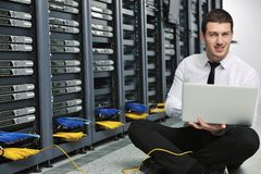 Businessman with laptop in network server room Stock Photography