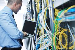 Businessman with laptop in network server room Royalty Free Stock Image