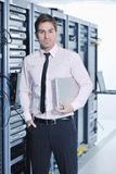 Businessman with laptop in network server room Royalty Free Stock Images