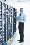 Businessman with laptop in network server room Royalty Free Stock Photos