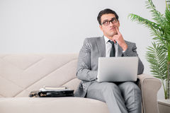 The businessman with laptop notebook sitting in sofa Royalty Free Stock Photography