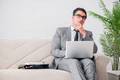 The businessman with laptop notebook sitting in sofa Royalty Free Stock Photo