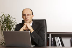 Businessman at laptop in office Stock Photos