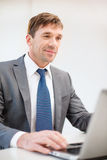 Businessman with laptop in office Royalty Free Stock Photos