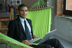 Businessman with laptop Royalty Free Stock Image