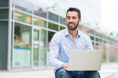 Businessman with laptop oudoor Stock Photo