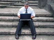 Businessman with laptop outdoor stock photos