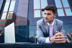Businessman with laptop outdoors Royalty Free Stock Images