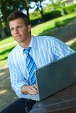 Businessman with laptop in park Royalty Free Stock Photography