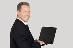Businessman with laptop. Stock Photos