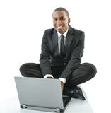 Businessman with laptop sitting on floor Royalty Free Stock Photos
