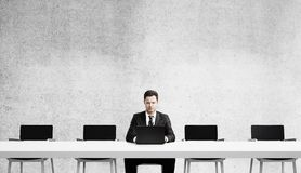 Businessman with laptop Stock Images