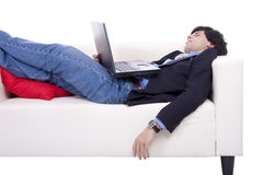 Businessman with laptop sleeping Stock Images