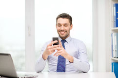 Businessman with laptop and smartphone at office Royalty Free Stock Photos