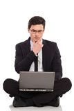 Businessman with laptop thinking. Stock Photo