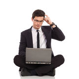 Businessman with laptop thinking. Royalty Free Stock Photography