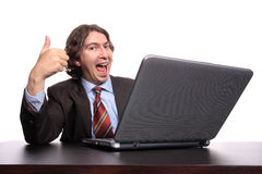 Businessman with laptop and thumb up Royalty Free Stock Photography