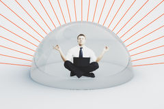 Businessman with laptop under shield Royalty Free Stock Images