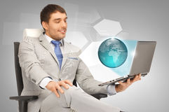 Businessman with laptop and virtual screens Stock Photography