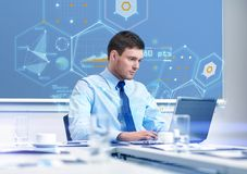 Businessman with laptop working in office Royalty Free Stock Images