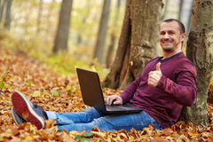 Businessman with laptop working outdoor Royalty Free Stock Photo