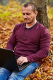 Businessman with laptop working outdoor Stock Image