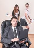 Businessman with laptop works in office Royalty Free Stock Photography