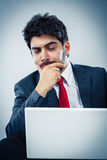 Businessman with laptop. Young man working on a laptop focused Stock Photos