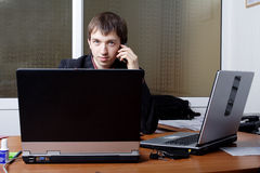 Businessman with Laptops Royalty Free Stock Image
