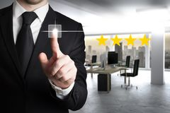 Businessman in modern office pushing virtual button four star review 3d illustration. Businessman in large modern office pushing virtual button four star review royalty free stock images
