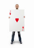 Businessman with large playing card stock image