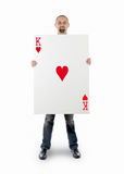 Businessman with large playing card Royalty Free Stock Photo
