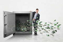 Businessman with a large safe full of money Royalty Free Stock Photos