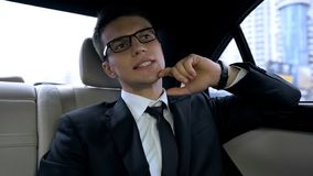 Businessman late for important dinner stuck in traffic jam, megalopolis life. Stock photo stock image