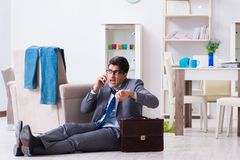 Businessman late for office due to oversleeping after overnight. Working Royalty Free Stock Images