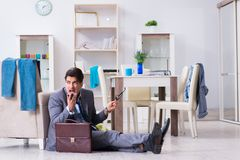 Businessman late for office due to oversleeping after overnight. Working Royalty Free Stock Image