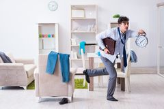 The businessman late for office due to oversleeping after overnight working. Businessman late for office due to oversleeping after overnight working Royalty Free Stock Photography