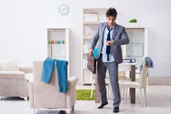 The businessman late for office due to oversleeping after overnight working. Businessman late for office due to oversleeping after overnight working Royalty Free Stock Image