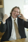 Businessman laughing. And cheering a succesfull deal at the phone Royalty Free Stock Photos
