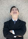 Businessman laughing with arms crossed Stock Image
