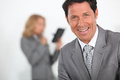 Businessman laughing Stock Photo