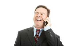 Businessman Laughing on Phone Call Stock Image