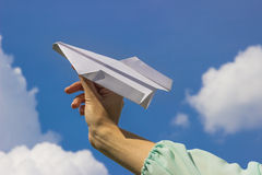 Businessman launching a paper airplane concept for business startup, entrepreneur, creativity and freedom Stock Images