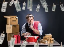 Businessman is laundering money in foam. Businessman is laundering money banknotes in foam in red washbowl Royalty Free Stock Photography