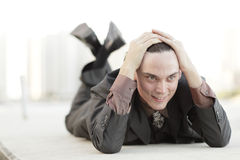 Businessman laying down Royalty Free Stock Photos