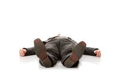 Businessman laying down in a suit Stock Images